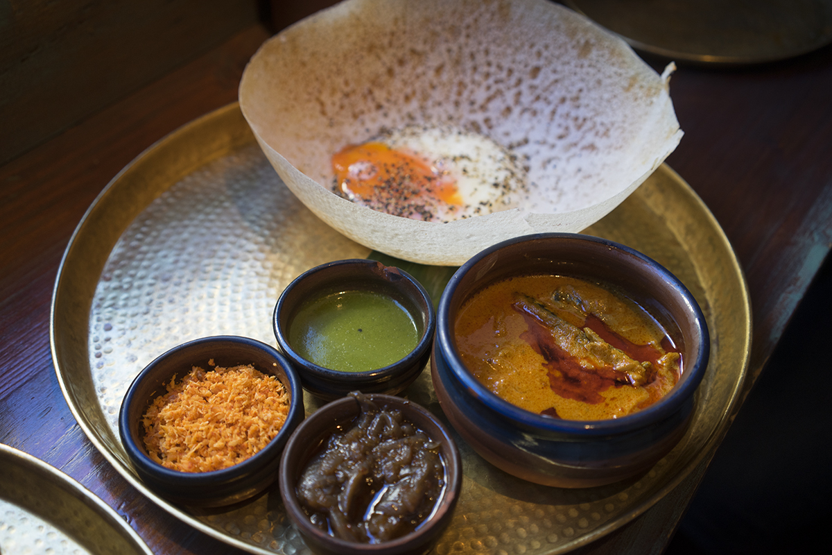 Hopper with an egg, chutney and fish curry