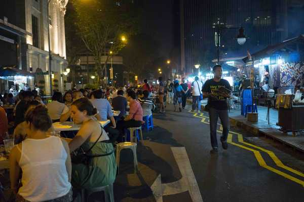 In the evening the street is closed to traffic and is overrun with tables and chairs for diners