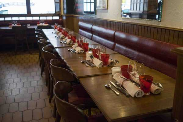 Long dining tables with wood and leather seats
