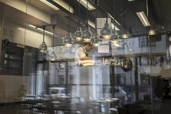 The elevated kitchen viewed through the huge glass door