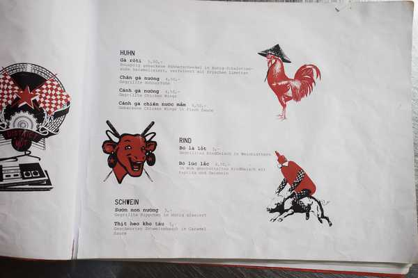Yes, the menu features a bottle of sriracha sauce riding a pig