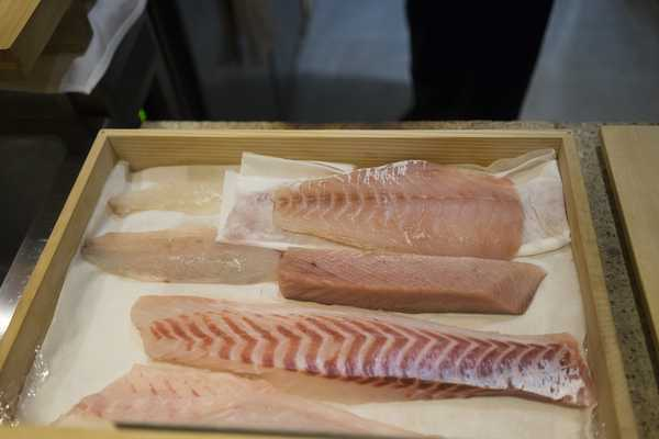Sashimi stored in chefs wooden box, note the pale buri (yellow tail), a favourite!
