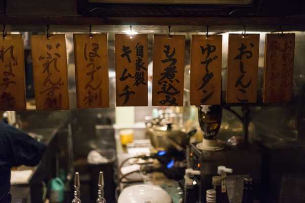 The menu hangs over the bar, but helpful staff speak pretty good Japanese