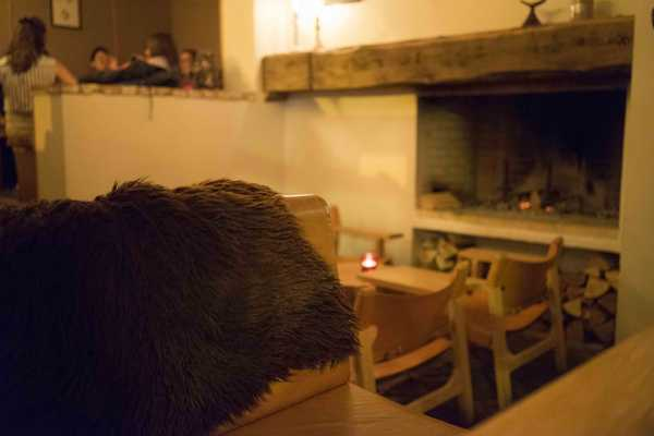 So hygge! Sheep skin seats and open fireplace