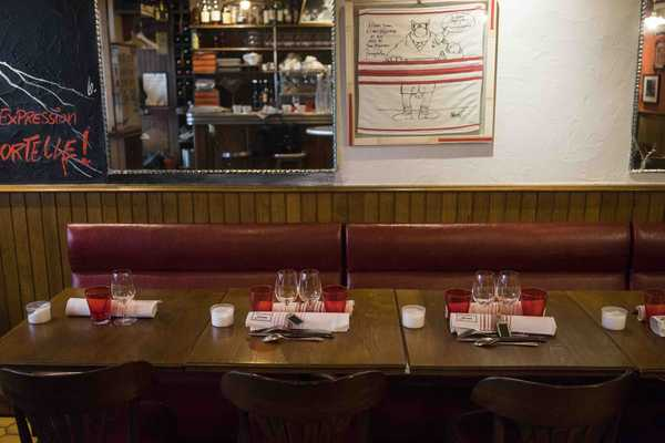 Table are typical French bistro, designed for bottoms, not elbows
