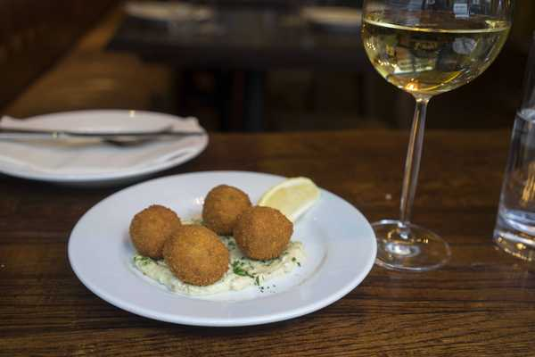 Salt cod croquettes with caper oil and lemon
