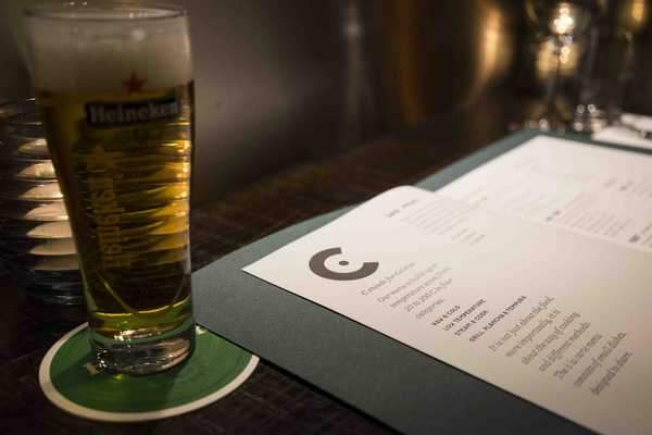 Heineken in Amsterdam while you study the menu