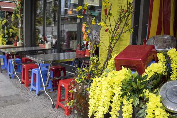 Tables line the outside of District Mot for summertime dining