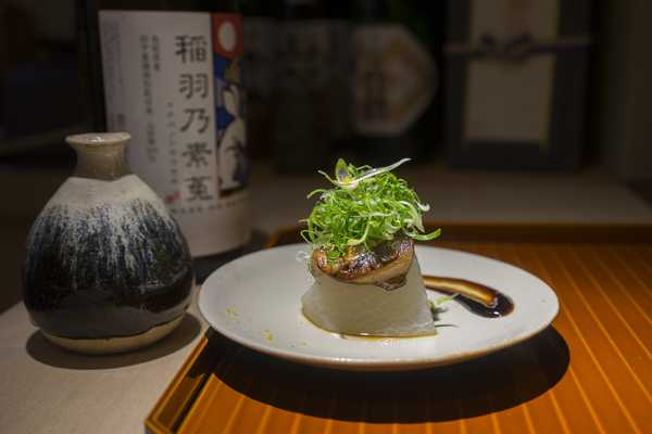 Daikon (radish) topped with grilled anago (conger eel) and spring onion